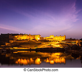 Amer Fort (Amber Fort) illuminated at night - one of...