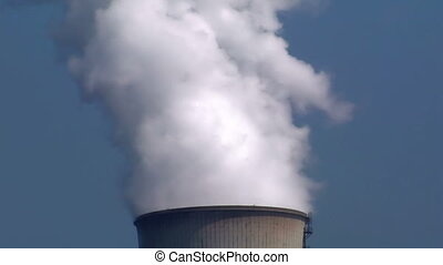 smoke cooling tower - Pollution: A smoking cooling tower....