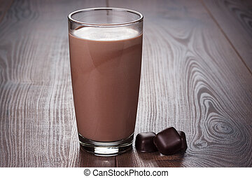 glass of chocolate milkshake on the table