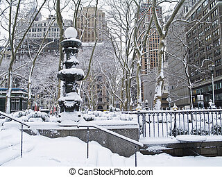 Winter Scene Bryant Park - A snowy view of Bryant Park in...