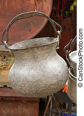 An antique pot hanging on display at a souvenir shop