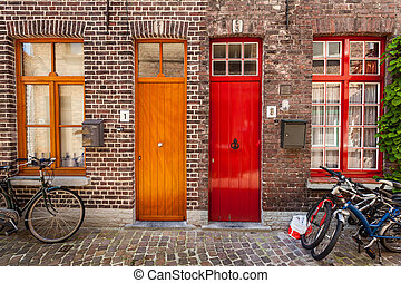 Doors of old houses and bicycles in european city. Bruges...
