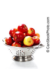 Fresh red apples in metal colander