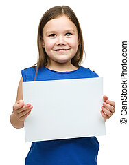 Little girl is holding blank banner, isolated over white