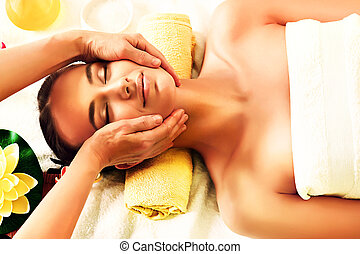 facial massage - Beautiful young woman taking spa treatments...