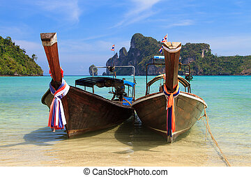 Beautiful bay of Phi Phi island Thailand - Long tailed boat...