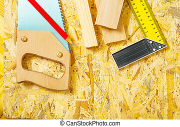 carpenter tools on plywooden board