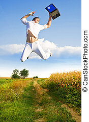 Agrarian revenue - Happy farmer jumping with laptop because...