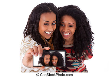 Young black african american teenage girls taking pictures...