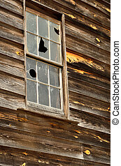 Broken out window in old mill house - Old wooden mill...
