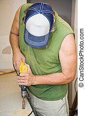 Drilling Through Laminate - Contractor using a power drill...