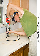 Sawing Formica Counter - Contractor uses a reciprocating saw...