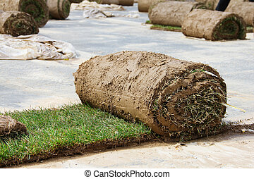 Turf grass rolls partially unrolled close up