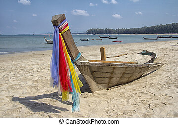 Long tail boat wreck on beach