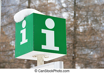 Information sign - Green Information sign in winter forest...