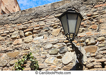 Old lantern in Alhambra - Old lantern and ancient wall in...