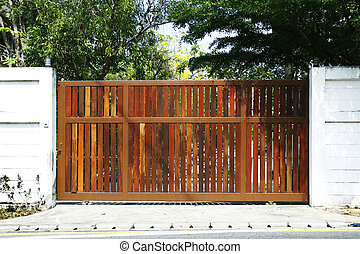 Wooden gate in front of home to close.