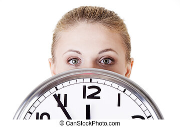 Shocked woman with clock - Portrait of shocked woman with...