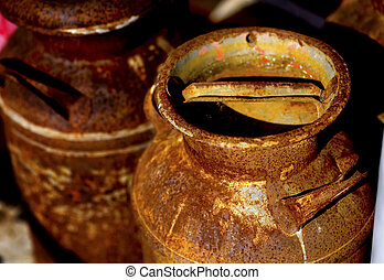 Milk Cans - Rusty milk can in the afternoon light of a...
