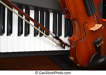 ViolinPiano - Violin and Bow resting on Piano Keys