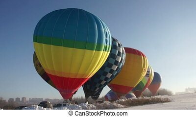 Colorful hot air balloons before starting
