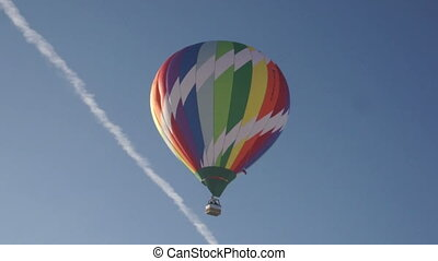 Image of rainbow hot air balloon in sky