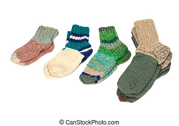 Knitted socks - Different woolen socks on a white background