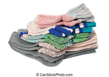 Knitted socks - Pile of woolen socks on a white background
