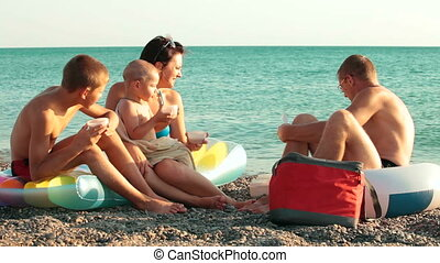 Family Summer Beach Vacation - Young family enjoying summer...