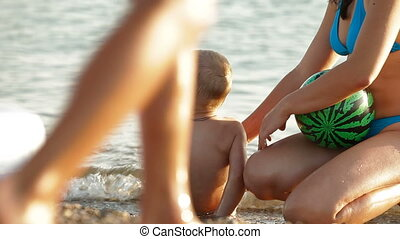 Family Summer Beach Vacation - Mother with kid enjoying...