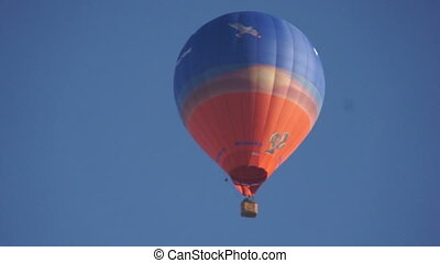 Image of blue and red hot air balloon, close-up