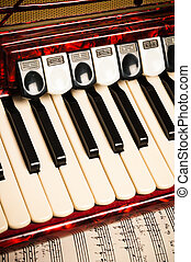 Red accordion and sheet music, closeup - Red accordion and...