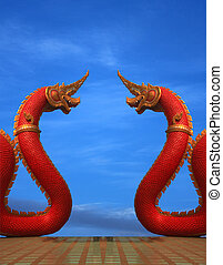 twain Naga statue of thailand with nice sky