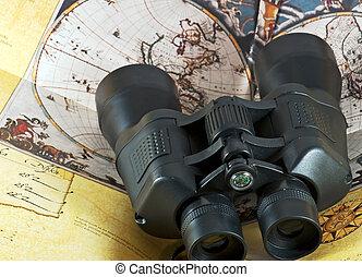 Binocular on old pirate map