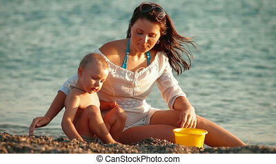 Mother with Child on Summer Beach
