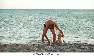 Father with kid on the summer beach