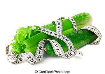 Celery zucchini squash and measure tape diet concept...
