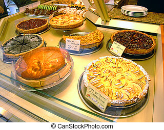 Display of pies in a french bakery - Display of pies in a...