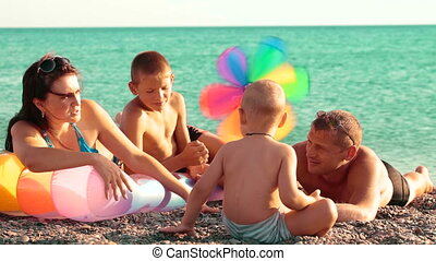 Family Summer Beach Holiday - Young family enjoying summer...