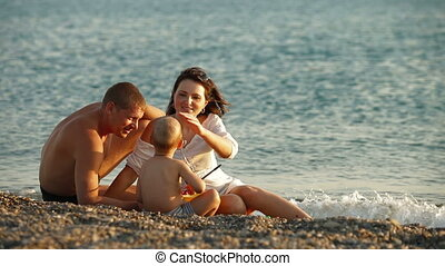 Family Summer Vacation On The Beach