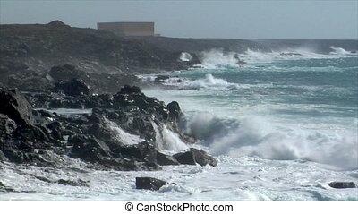 extreme wave crushing coast spray