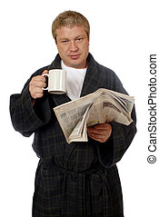Morning Routine - A man in his bathrobe drinking coffee...