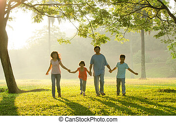 family outdoor enjoying qualitye time together, asian people silhouette during beautiful sunrise