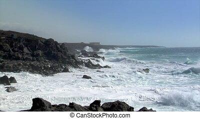 extreme wave crushing coastline wid