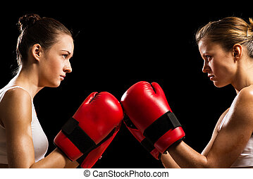 confrontation between the two women boxers - two female...