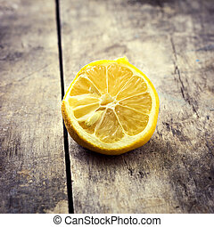 Withered Half Lemon on old wooden table,retro look