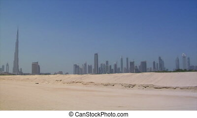 Dubai skyline pan burj emirates traffic no visible signs or...
