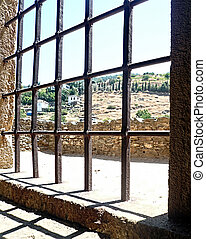 Village houses through window bars - Scenery of an old...