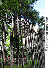 Wrought iron fence surrounding a garden