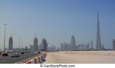 highway traffic at dubai skyline